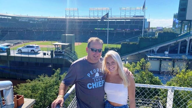 Don Keeley and his daughter, Kaitlyn, brought a pocket full of $100 bills and landed a spot on Murphy's rooftop outside Wrigley Field on Wednesday, Aug. 19, 2020, so they could keep a promise made to former Peoria Chiefs pitcher Johan Oviedo to see him make his MLB debut. Oviedo was called-up Wednesday by the Cardinals to start the second game of a doubleheader against the Cubs.