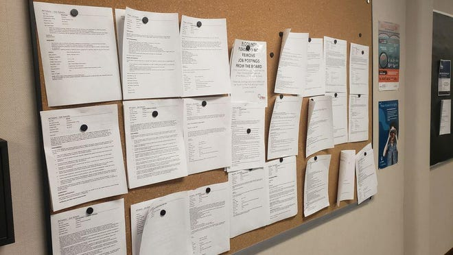 A bulletin board showing job postings at Michigan Works! Southeast in Adrian is pictured.