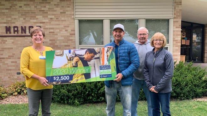 Terrie Rothmeier (left) received the donation from Aaron Simonsen, Dave Simonsen and Joanne Simonsen.