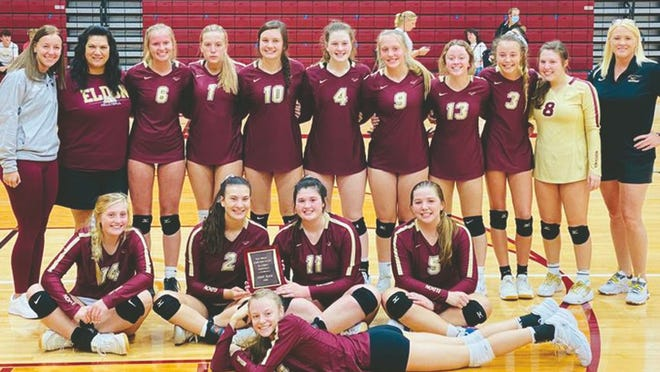 The Eldon volleyball team celebrates its championship run in the 38th annual Eldon Tournament on Saturday, October 10, in Eldon. The Mustangs swept all six of their opponents in two sets.