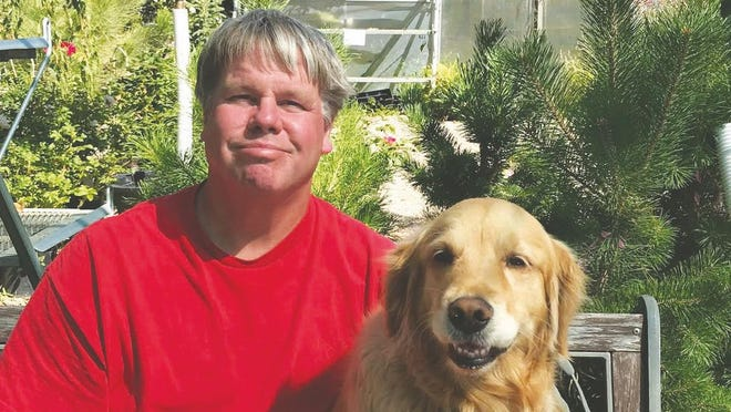 Mark E. Olson and Goldie.
