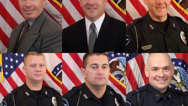 Top row from left: Captain Hank Harper, Detective Sergeant Derrick Dillon and Sergeant Tim Mayfield. Bottom row from left: Sergeant Steve Gray, Investigator Chris Giacolone and Corporal Tom Grisham.
