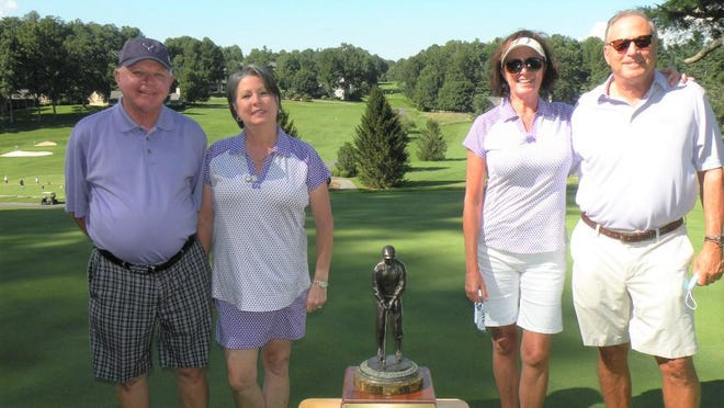Joanne Jones Trophy winners from the 2020 Kenmure Fights Cancer benefit are from left: Dave and Lisa Caudle, and Angela and Doug Blankman.