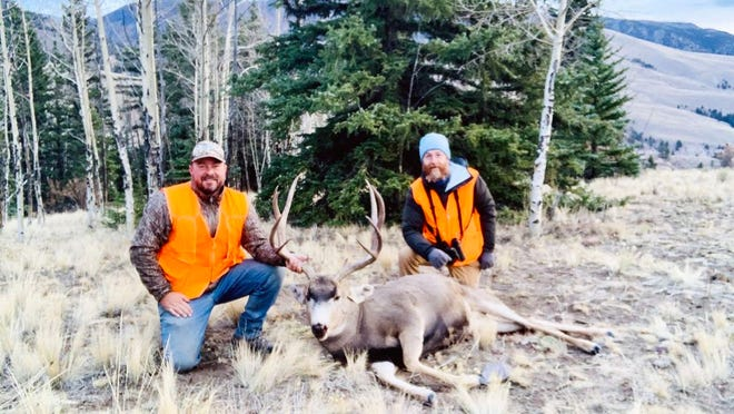 Lifelong friends, Brandon Butler and Jeremy James, are all smiles with Brandon's Colorado mule deer.