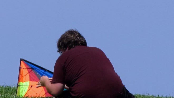 Flying kites at Castle Island is a lot of fun - once they are ready to get into the air.