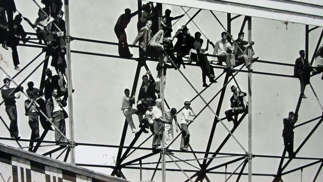 Fans used to climb up this roof billboard outside Fenway Park to get a free look at the Red Sox in action.