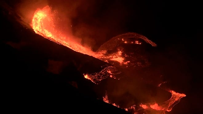 In this photo provided by the U.S. Geological Survey, lava flows within the Halema'uma'u crater of the Kilauea volcano Sunday, Dec. 20, 2020. The Kilauea volcano on Hawaii's Big Island has erupted, the U.S. Geological Survey said.