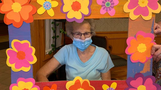 Myma Sheldo, 87, poses with a decorated picture frame after receiving the COVID-19 vaccine Jan. 14 at Aspen Grove Senior Living.