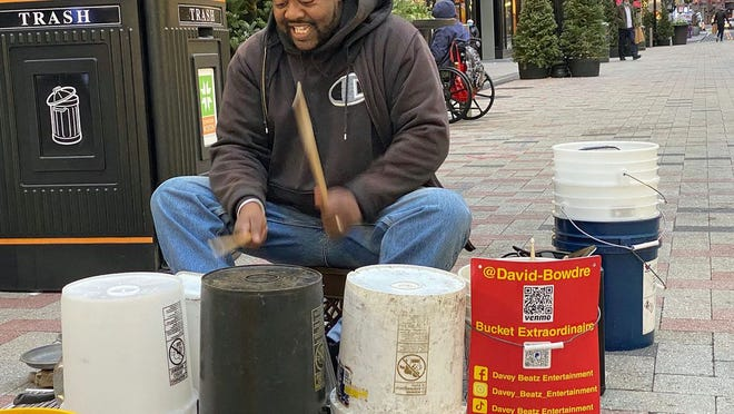 David Bowdre entertains shoppers in Downtown Crossing with his outstanding drumming. He has been bringing joy to people with his musical skills for many years. To learn more about him, visit www.daveybeatz.com.