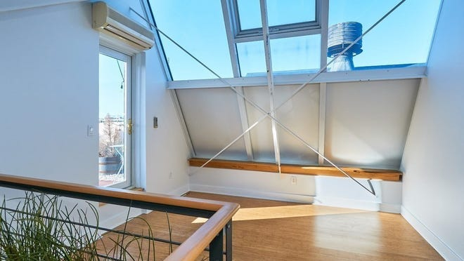 The loft, brightened by a skylight gable, can be a home office, den, gym, yoga room, greenhouse or third bedroom. Its storage alcove can become a closet.