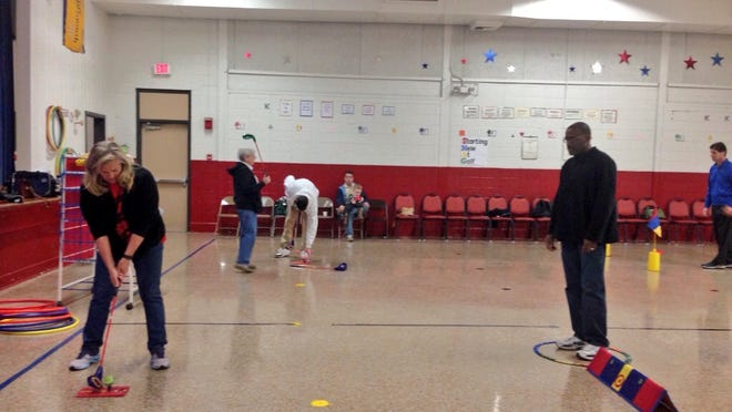 About 10 physical education teachers from schools across Rapides Parish learn to use golf to teach core values and life skills with The First Tee National School Program at a professional development session at Alma Redwine Elementary New Vision Academy on Friday.