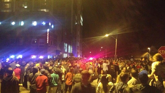 Crowds gather early Wednesday at Stanton Avenue and Chamberlain Street in Ames. Ames police said they were well-prepared for Veishea-related activities this weekend, but the timing of this incident took them by surprise.