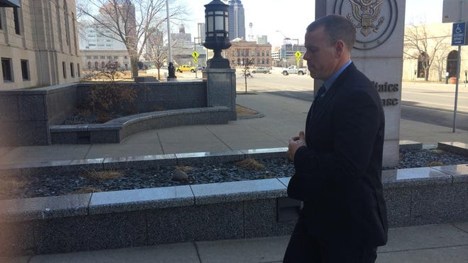 Colin Boone arrives at the federal courthouse for the verdict.