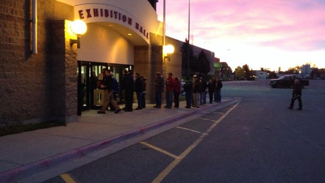 Voters line up outside the poll in Great Falls at Montana Expo Park early this morning.