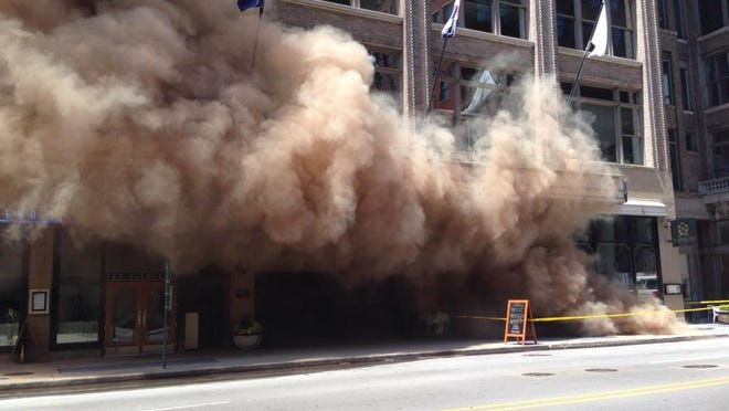 Smoke flows from an underground transformer in the 100 block of S. Meridian St. on Wednesday.