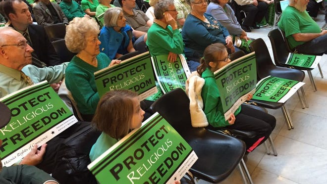 Supporters of the religious freedom bill attend a Statehouse rally on Monday.