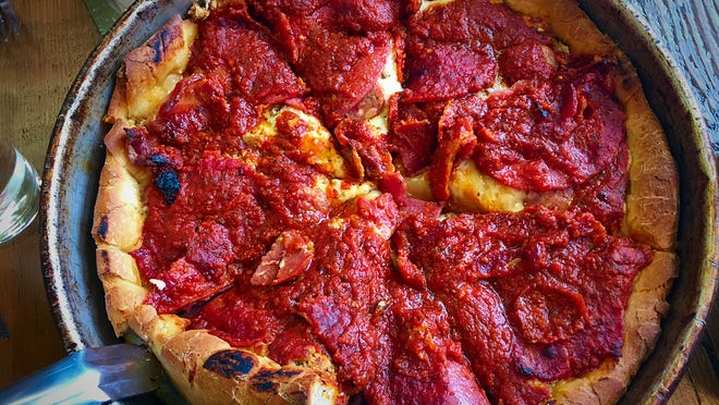 The Italian Stallion Medallion ($17) is a deep dish pizza with rich tomato sauce, pepperoni, Italian sausage, Andouille, salami, bacon and mozzarella cheese