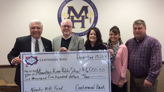 Centennial Bank recently donated $6,500 to the Mountain Home School District. The donation will go to all Mountain Home public schools and contribute to the needs of students for supplies, clothing and activities. Shown are Superintendent Lonnie Myers, from left, and Marketing President Phillip Young, Tabitha Hall, Kathryn Hicks and Shane Davis, all of Centennial Bank.