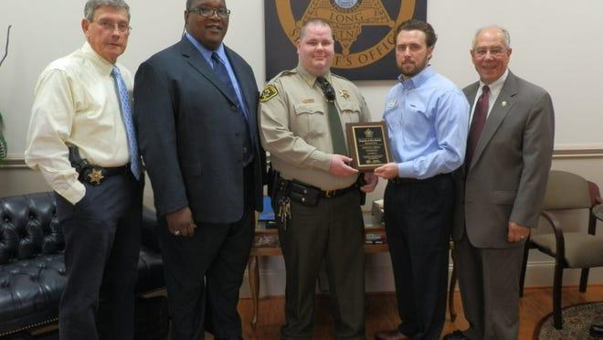 From left are Chief Deputy Dusty Rhoades, Capt. Freddie Moore, Deputy Brin Watson, Kris Krabill and Sheriff Jeff Long.