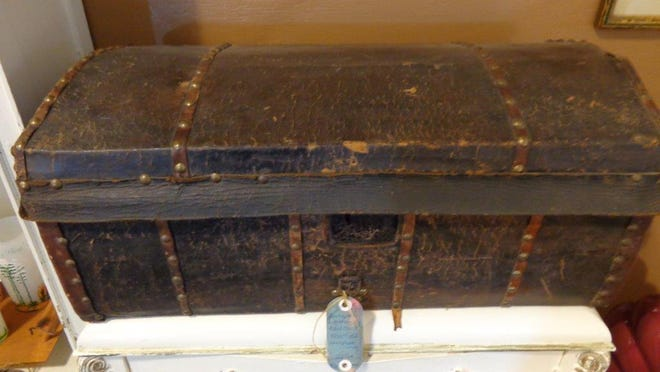 This leather-covered wooden trunk, circa 1835, featured two original iron handles, square nails and a newspaper lining of newspapers from this same period. This piece of rare Americana is $225 at AEG Antique Emporium & Gallery, 7609 East Pinnacle Peak at Miller in Scottsdale. Credit: Larry Cox.