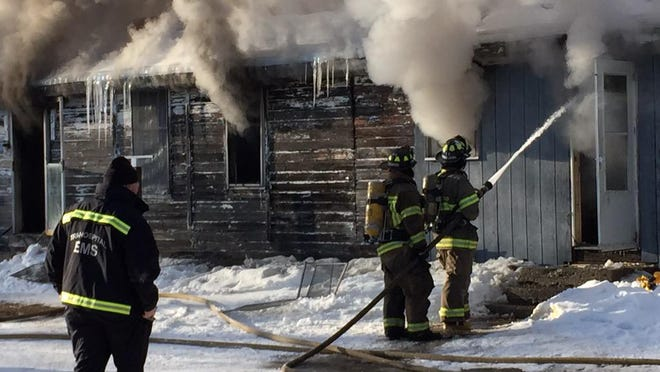 Firefighters battle a fire at an apartment building at 5420 Griswold Road. Crews from several different departments responded on Friday, Feb. 27, 2015 to battle the blaze.
