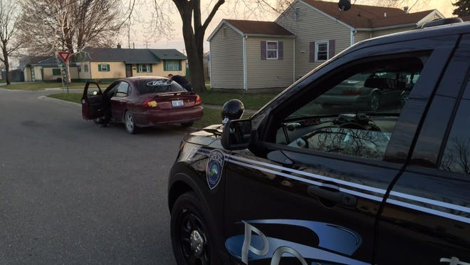 Lt. Roger Wesch conducts a traffic stop during a police sweep in Port Huron Friday.