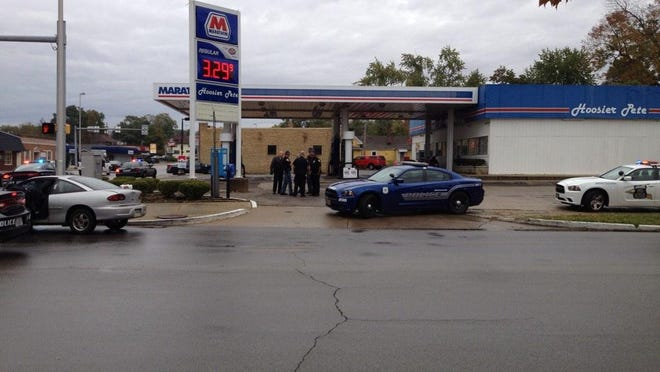 Richmond police officers investigate a robbery of the Hoosier Pete gas station Thursday morning near downtown Richmond.