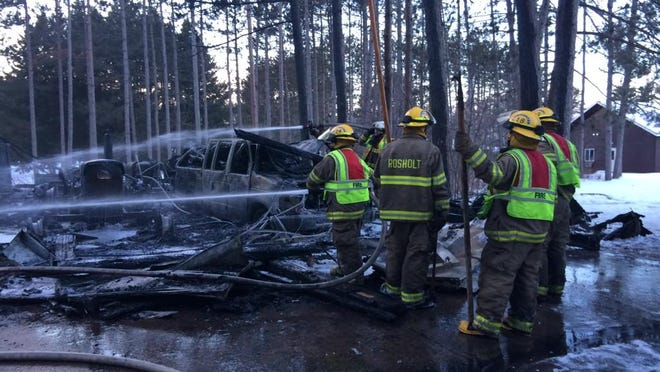 A garage at the Wisconsin Lions Camp in Rosholt is a total loss after a fire Sunday afternoon. A tractor and vehicle also were lost in the fire.
