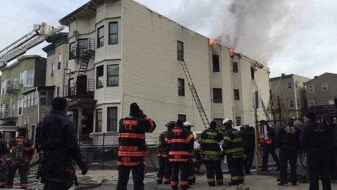 Yonkers firefighters responding to a multi-family house fire at 56 Groshon Ave. Wednesday.