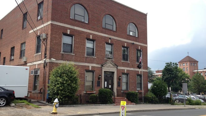 The former Rye Town Hall in Port Chester will be razed and replaced with a parking lot for nearby Neri's Bakery and the Capitol Theatre.