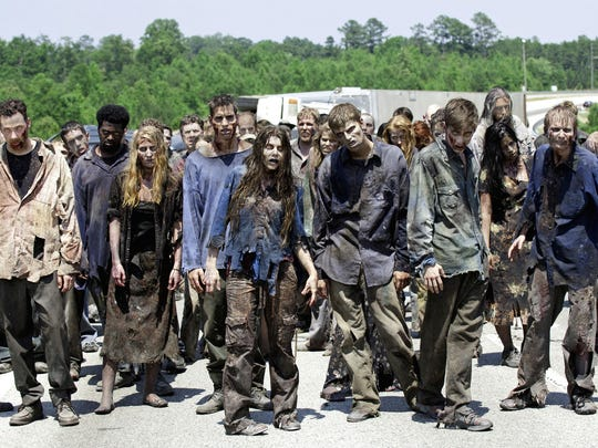"In this image released by AMC, zombies appear in a scene from the second season of the AMC original series, ""The Walking Dead."""