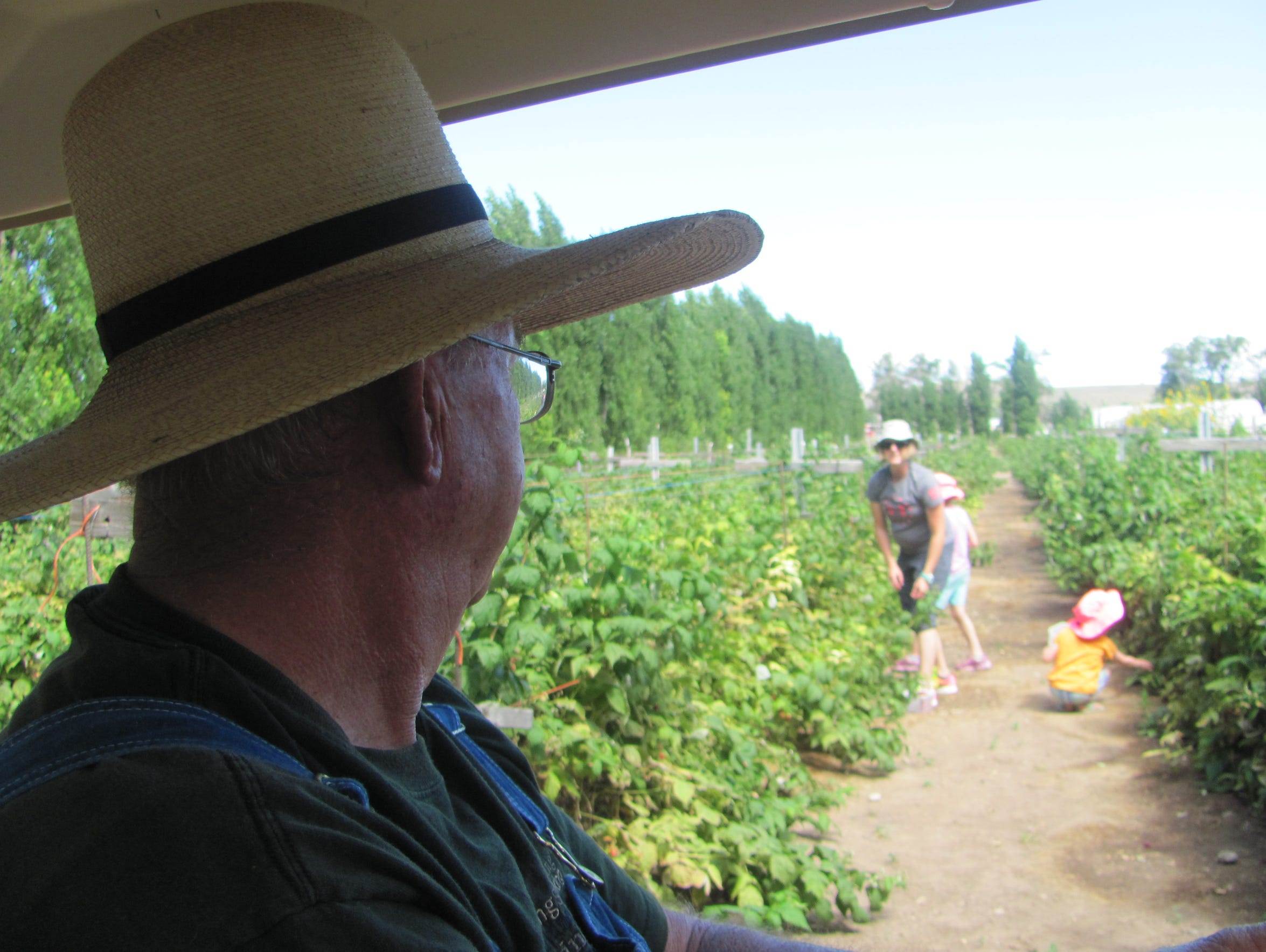 "Farmer Darrel Humphries chats with ""U-pickers"" gleaning"