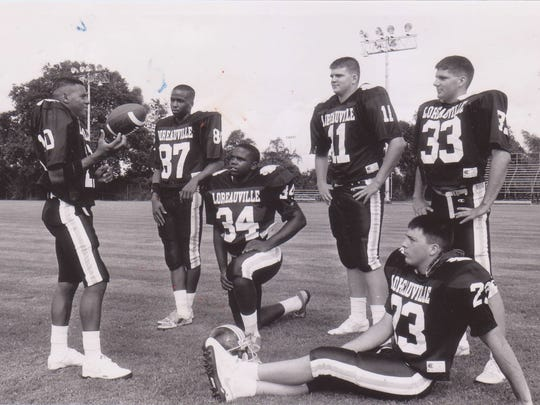 Loreauville quarterback Michael Vital (10) surveys his weapons Peter Zenner (87), Andrew Roberts (34), Cody Romero (11), Scott Angelle (33) and Corey Judice (23) during picture day before the 1991 football season.