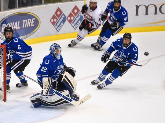The puck bounces in front of University of Alabama-Huntsville goaltender Jordan Uhelski during the first period of the Friday, Oct. 28, game at the Herb Brooks National Hockey Center in St. Cloud.