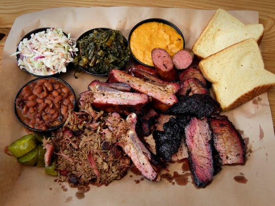 Iron Grate BBQ Co.'s menu includes brisket, sausage, rib and pulled pork. Side dishes include baked beans, grits,  coleslaw and greens. Iron Grate is at 4125 S. Howell Ave.