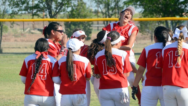 Loving celebrates Thursday's 2-1 district win over Dexter.