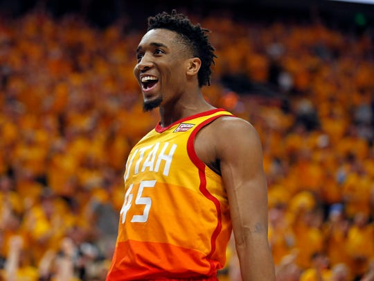 Utah Jazz guard Donovan Mitchell celebrates after scoring against the Oklahoma City Thunder during the second half of Game 3 of an NBA basketball first-round playoff series Saturday, April 21, 2018, in Salt Lake City. The Jazz won 115-102.
