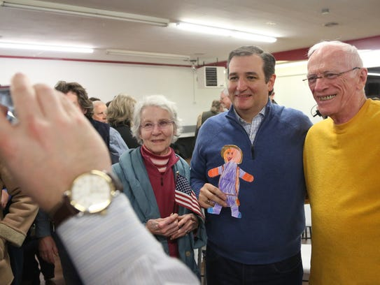 Presidential hopeful Ted Cruz poses for a photo with