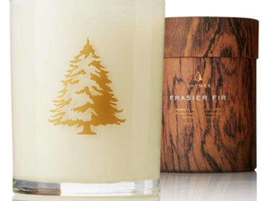 The Aromatic Wood Wick candle in Christmas Tree scent.