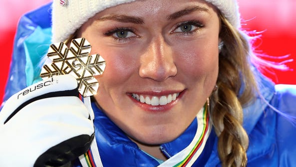 Mikaela Shiffrin poses with the gold medal of the women's