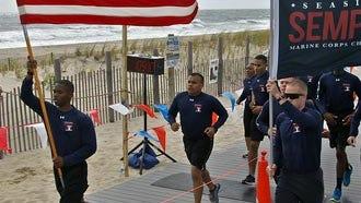 Runners in the 2015 Seaside Semper Five on the boardwalk in Seaside Park.