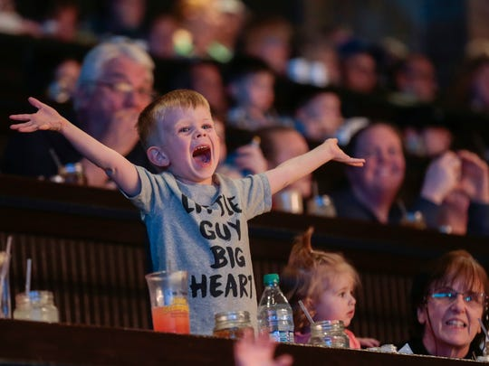 "Sgt. Bryan Samsel's son Axton Samsel, 4, yells ""My daddy's home!"" at Dolly Parton's Stampede after Sgt. Samsel's surprise homecoming from a one-year deployment to the Middle East."