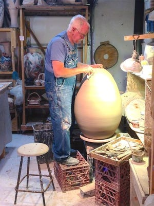 Tony Staroska creates an egg form at his Juddville Clay Studio Gallery. Staroska and Rebecca Carlton of Juddville Clay and Ginnie Cappaert of Cappaert Contemporary Gallery co-host their third annual Artist Demo Day on Sept. 23.
