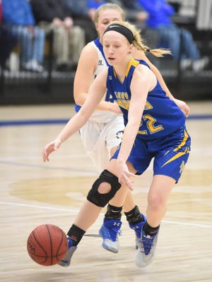 Mountain Home's Hannah Pfeifer dribbles around a Harrison defender during the Lady Bombers' 43-30 victory on Friday night at Goblin Arena.
