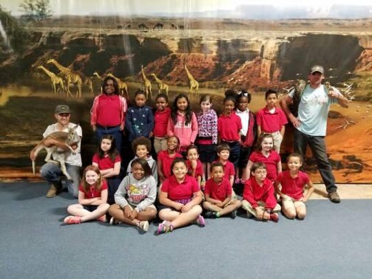 Twenty Pineville Elementary students saw exotic animals like this baby kangaroo and boa constrictor Monday at Gone Wild Safari in Tioga. It was a reward trip from Rapides Parish District Phillip Terrell for students with good behavior.