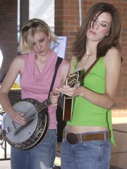 The Severin Sisters, Amy left and Heidi right, perform