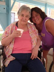 Carole, left, and her sister Janice Scalise visit at the Iowa Mental Health Center at Clarinda.
