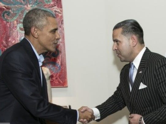 President Barrack Obama greets Lafayette businessman