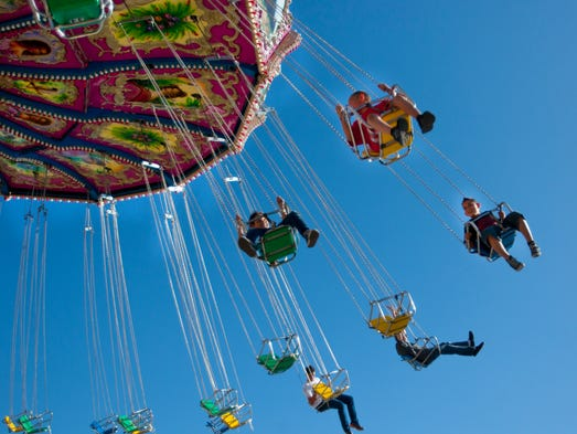 Guests soar through the air on an a Merry-go-Round at the Maricopa County Fair on April 13, 2014.