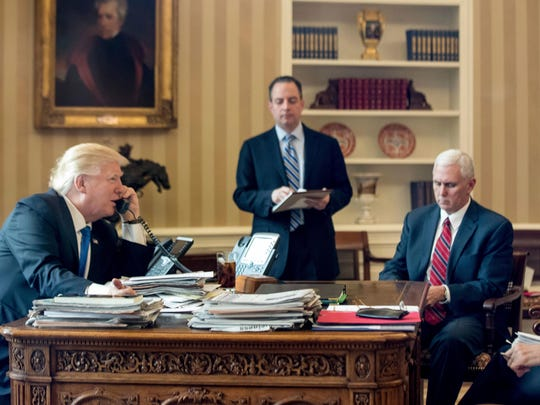 President Donald Trump has a portrait of Andrew Jackson, top left, hanging in the Oval Office. Trump is shown accompanied by former Chief of Staff Reince Priebus and Vice President Mike Pence in the Oval Office at the White House in Washington, D.C., on Jan. 28, 2017.